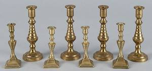 Set of four English miniature brass candlesticks