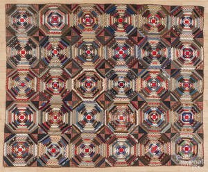Pieced log cabin variant quilt