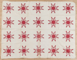 Red and white pieced quilt