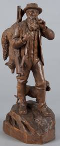 Continental carved figure of a hunter