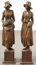 Pair of carved women on pedestal bases