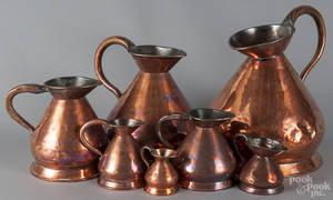 Assembled set of seven English copper haystack measures