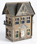 Painted tin model house