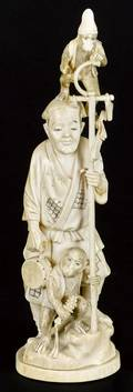 Japanese Meiji period carved ivory figure of a man and two monkeys