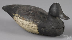 Two carved and painted black duck decoys early 20th c