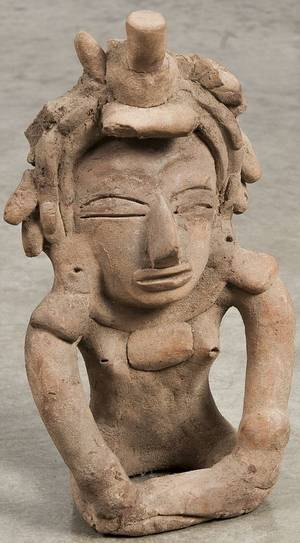 Early seated clay figure