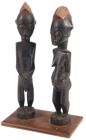 African carved and polychrome painted male and female figures