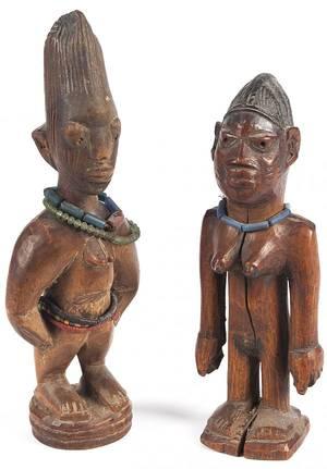 Two African carved ewe ibesi figures of the Yoruba people