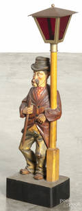 German carved pine clockwork whistler with a lamp post