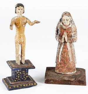 Two South American carved and painted Bultos