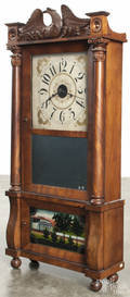 Forestville mahogany double decker mantel clock with a carved eagle crest