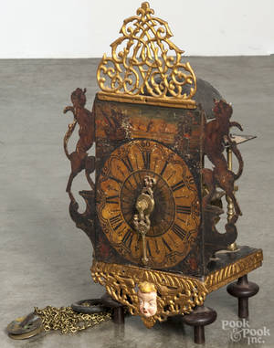 Dutch Frisian wall clock with a gilt and painted surround and ebonized hooded wall bracket with carved mermaids