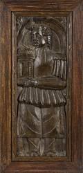 English carved oak panel depicting Saint Barbara holding her tower