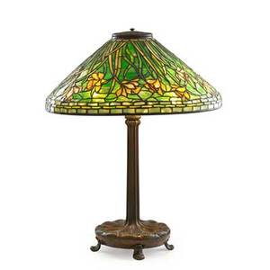 Tiffany studios table lamp with daffodil shade new york 1900s bronze leaded glass three sockets shade stamped tiffany studios new york base stamped tiffany studios new york 395 overall 26 x