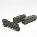 Lionel locomotive together with two coal cars