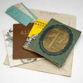 Railroad memorabilia including wooden whistles magazines photographs payroll stubs booklets checks and other related ephemera