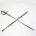 United states naval sword with sharkskin grip and engraved blade covering on scabbard with damage length 36