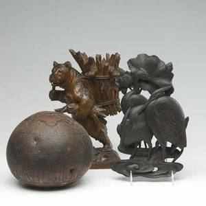 Decorative carvings including a black forest style carved bear wallhanging with cranes in a pond and a highly decorated south american gourd box bear 12