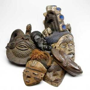 Six carved wooden african masks large mask flanked by two animal figures and stylized central crest two ivory coast masks with stylized facial features and hair and hooks for hanging mask from zaire