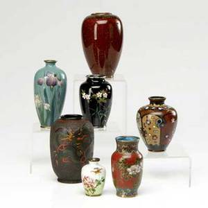 Japanese cloisonne seven pieces including a totai vase on porcelain with dragon decoration signed one with tea goldstone decoration one with iris decoration and four others tallest 4 34