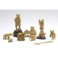 Ivory grouping of twelve pieces including a netsuke and seven animal figures largest 3 34