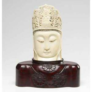 Chinese ivory buddha head mounted on a fitted and carved wooden base 14 12