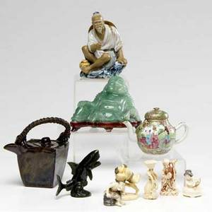 Asian items ten pieces four ivory netsuke one resin statuette a teapot with bamboo handle a rose medallion teapot one hardstone figure of hotei one hardstone fish and a chinese porcelain figure