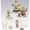 Asian ivory eleven pieces two carved ivory covered jars arachaicstyle decoration both with wooden bases together with a japanese okimono oval horn box with incised decoration and hinged lid two