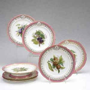 Porcelain dessert set handpainted with various fruit and gilt border on a pink ground possibly old paris comprising six plates and a footed dish plate 8 34 dia