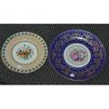 Service plates including twelve rosenthal ivory with blue and gold trimmed border together with a set of twelve cauldon china luncheon service plates twentyfour pieces total largest 11 dia