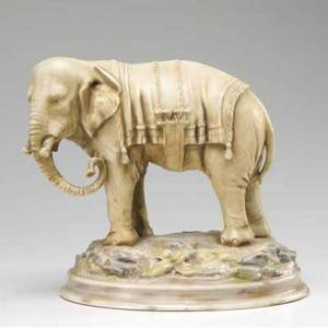 Continental ceramic porcelain figure of an elephant marked on the base with company monogram 9 14 x 9 12