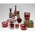 Cranberry glass twelve pieces includes four deep dishes with acidetched vine and grape decoration acid etched tazza with stemmed foot two vases one bottle with stopper three goblets and one cove