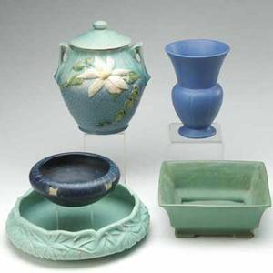 Roseville etc five pieces roseville blue clematis cookie jar a weller marvo bowl in pale blue monmouth blue flaring vase peters  reed bowl and a roseville green flaring bowl four marked cooki