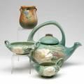 Roseville threepiece green peony tea set with a brown columbine vase 124