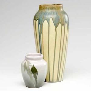 Ohio two vases one peters  reed or weller with dripping blue green and brown glaze on a yellow ground and one owens painted with leaves owens markedno 217 12 and 4 12