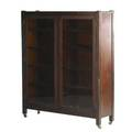 Mahogany two door bookcase with glass panes adjustable shelves and caster feet ca 1900 58 12 x 13 x 46