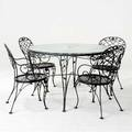 Woodard patio set including a dining table with hammered glass top and four armchairs all stamped woodard table 29 x 47 12 dia
