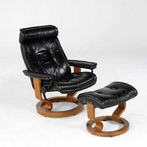 Modern armchair and ottoman on wooden frames upholstered in black leather chair 39 x 29 x 24
