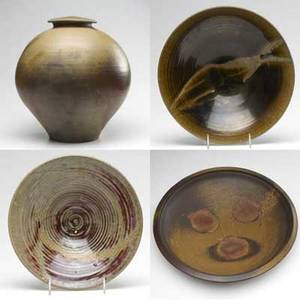 Jack troy and gordon andrus massive centerpiece bowl and covered jar in brown glazes along with two wheelthrown flaring bowls in brown and red glazes with abstract designs in resist all signed lar