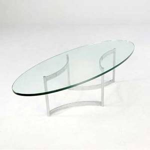 John stuart coffee table with elliptical glass top on polished steel base 16 x 58 x 24