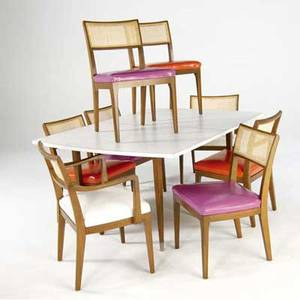 Midcentury modern ninepiece dining suite extension dining table with white laminate top and three 18 leaves and eight dining chairs with caned backs and vinyl upholstery table closed 29 x 63