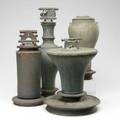 Tim mather four glazed stoneware jars on stands three with lids tallest 20 x 6 12 dia