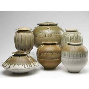 Tom turner six porcelain covered jars covered in brown olive and ash glazes all signed largest 10 12 x 11 12