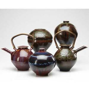 Tom turner five porcelain items teapot and two jars covered in brown green and tan teadust glazes teapot covered in oxblood glaze and jar covered oxblood and purple glazes all marked tallest 12