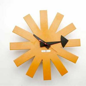 George nelson  howard miller asterisk clock with orange enameled metal body howard miller metal tag 10 dia x 2 34