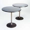 Modern pair of pedestal side tables with granite tops and bronze bases from the estate of peter joseph 29 x 30