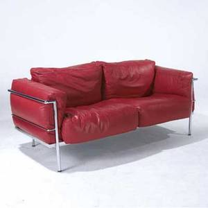 Le corbusier settee on polished chrome frame its cushions upholstered in cherry red leather 31 x 66 x 30