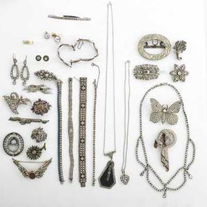 Collection of silver and paste jewelry thirtyone pieces include necklaces earrings bracelets brooches and buckles some silver topped gold elements including georgian brooch set with rubies de