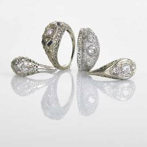 Platinum or 18k white gold diamond filigree rings four pieces handbuilt platinum filigree with three bezel set diamonds size 6 three stamped 18k gold filigree rings with diamonds some sapphire a