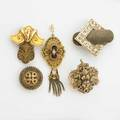Five victorian yellow gold pendants includes bold geometric and scrolling black and white taille depargne enameling or cannetille two with split pearl accents 12k14k yg largest 1 12 x 1 12